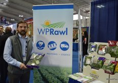 Ashley Rawl with WP Rawl showing seasonal harvest kale.