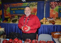David Anthony of Ruby Fresh showing pomegranates in the booth of Nathel & Nathel. The company markets Ruby Fresh's pomegranates in the NY area.
