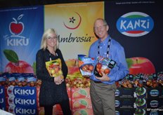 Katherine Grove and Tim Welsh with Columbia Marketing International showing Ambrosia and Kiku pouch bags of apples.