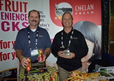 Bill Dinham and Mac Riggan with Chelan Fresh showing Rockit apples and the Cup O'Cherry packaging.