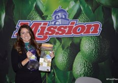 LeighAnne Thomsen with Mission Produce, Inc. shows avocados as well as a brochure with information about a recent relaunch of the company's website.