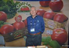 Michael Ryshouwer with Bejo Seeds in front of the Tasti-Lee tomato display.