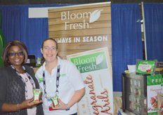 Claire Sakho with Global Bloom and Stefanie Katzman of Katzman Produce showing pomegranate arils.