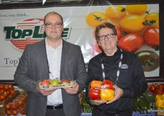 Max Mastronardi and Matt Wright of Westmoreland- TopLine Farms showing heirloom tomatoes and colored bell peppers.