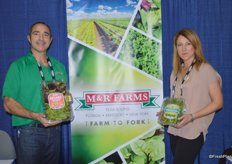 Anthony Perez and Arit Brener with M&R Farms showing organic spring mix and watercress.
