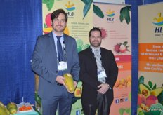 Lorenz Hartmann de Barros and Rubens Zylberkan with HLB Specialties showing organic Formosa papayas.