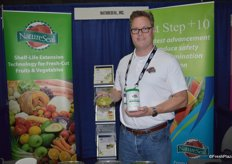 Brendan Foley with NatureSeal showing the company's new product that maintains the natural color of fresh- cut avocado and guacamole without altering the flavor.