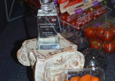 Close-up of the finalist award and lorabella tomatoes.