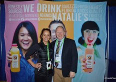 Lucy Sexton and Michael D'Amato are making show attendees happy with samples of Natalie's Orchid Island juice.