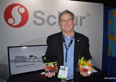Tom Muller with Schur Systems sells both the equipment and packaging of the products that Tom is showing in the picture.