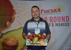 Jose Juan Rodriguez with Freska Produce. Jose shows mangos from Ecuador. Peruvian mangos will arrive in two weeks.