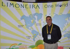 John Caragliano with Limoneira stands in front of the world map that shows Limoneira's citrus growing locations. The company's lime program starts in January.