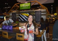Helen Aquino with Village Farms proudly shows the 5oz. bags with heavenly villagio marzano tomatoes. They are now available at Disney Parks as well as the Epcot Food & Wine festival.