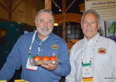 Jose Marrero with Farm Stand Fresh Foods and Jeff Trickett with Bejo Seeds, showing organic Tasti-Lee tomatoes.