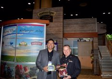 Jerry Moran and Archie Taylor with Naturipe Farms. Jerry shows the compostable recyclable organic blueberry package and Archie shows a package with cranberries.