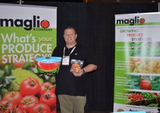 Richard Butera with Maglio Companies showing the 1 lb. Chunked Melon Solution.