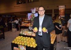 Robert Shueller with Melissa's showing Kensington Pride mangos that will soon arrive from Australia.
