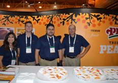 Courtney Rodriguez, Denver J. Schutz, Armando Castrejon and Denver Schutz with Gerawan Farming. The company served peaches to show attendees.