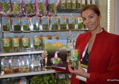 Cami Onolfo, author of the book Miracle Herbs & Plants proudly shows tea mixes in the booth of Coosemans/Rock Garden.