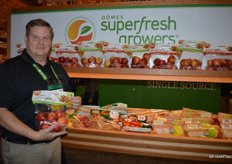 David Roby with Domex Superfresh Growers proudly shows the company's new harvest of Autumn Glory apples.