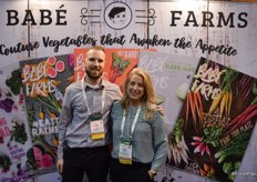 Matt Hiltner and Ande Manos with Babe Farms in front of a new backdrop that provides a brief overview of the company and its products.
