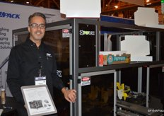 Anthony Del Viscio with Eagle Packing proudly shows a machine to pack boxes of produce