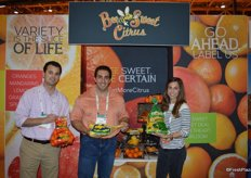 Joe Berberian, Jason Sadoian and Monique Bienvenue with Bee Sweet Citrus show some of the company's products: mandarins and lemons.