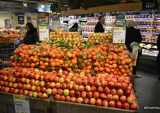 Promotional display that includes Junami apples and stem & leaf satsuma's. The signs clearly show that this is a promotional item.