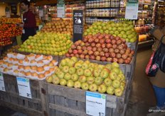 Selection of pears, grown locally in Connecticut as well as Washington and Oregon. The signage in the middle of the display explains customers how to best store this product.