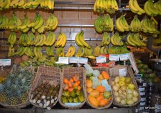 The other side of the display holds bananas as well, but also more exotic items like star fruit, dragon fruit, persimmons and yucca.