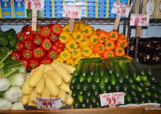 Vegetable display including bell peppers from the Netherlands.