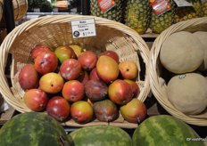 Red mangos from Brazil offered at $2.99 a piece.