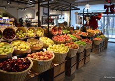 The food market is entered through the produce department. Many produce items are merchandised in baskets.