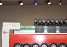 A view of small rollers used for smaller fruits and veg. These can be replaced with larger sized rollers on machines with the same track system.
