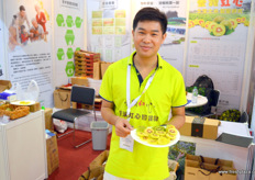 Hai Jian Li presents his company's red hearted and green Chinese kiwifruit at Sichuan Huapu Modern Agriculture. Sichuan province is a large producing region of Chinese kiwifruit.
