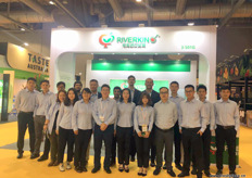 The full team of Riverkin in front of the stand. The company is a large importer of, among other products, cherries into China.