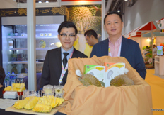 Director Tan Sue Sian (r) with a colleague at Top Fruits stand (Malaysia)