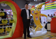 General manager Sun Yanshu standing next to their company mascotte.