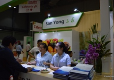 San Yong staff helping clients at their counter