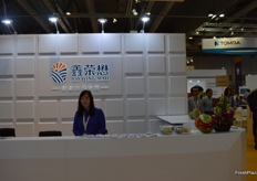 Rachel Li at the front desk of Joy Wing Mau Group.