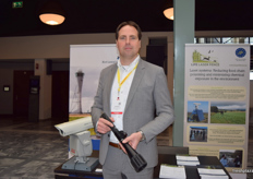 Imre Knol, displaying the lasers used for scaring off birds at the Bird Control Group stand.