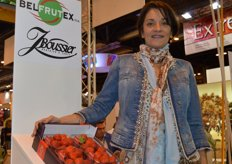 Annick Boussier poses with one of her main products: Belgian strawberries. Top fruit and tomatoes are also marketed. Vine tomatoes and snack tomatoes are a speciality for Boussier in the field of tomatoes.