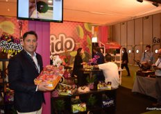 Sigfrido Molina, at his stand promoting Ready to Eat mangoes, avocados and aromatic herbs.