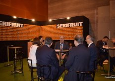 Vicente José Serisuelo, manager of Serifruit, Castellon-based firm devoted to the production, export and import of citrus, attending a customer at the stand.