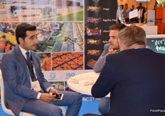Askin Ucak, speaking with visitors at the Ucak stand.