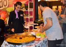 Tasting of paella with avocados.
