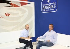 Coen Klok of the Spanish soft fruit producer Surexport, left, in conversation with a customer.