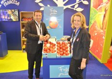 """Marc Peyres and Dina Abella from Blue Whale with the ""best of the best"" variety Fuji."""