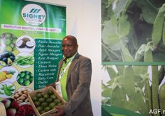 Isaac M. Muigou from Signet with avocados. This Kenyan company also exports various exotics, including the Hass avocado.
