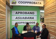 An animated conversation in the stand of Coopprobata from the Dominican Republic.